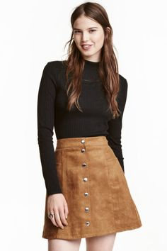 A-line skirt: Short A-line skirt with buttons down the front.