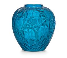 PERRUCHES VASE, NO. 876 designed 1919, electric blue and white stained engraved R. Lalique No. 876, 10 ¼ in. (26 cm.) high