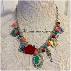 **Made to Order***  This necklace features 5 handmade Loteria images and beautiful glass beads. Ive also added charms inspired by Loteria.