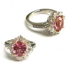 This stunning custom ring contains a 2.80 carat Padparadscha Sapphire and 1.29 carats of oval diamonds all set in 18k gold and platinum. #imagesjewelers #customjewelry #ring #sapphire #diamond #pink
