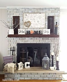 DIY fireplace renovation; a step-by-step tutorial on how to whitewash brick and update brass. Source list of fireplace decor included. #rustichomedecor