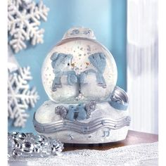 "Snow Buddies Waltz Waterglobe from Koehlerhomedecor.com - A loving snow-couple shares a tender moment, waltzing gracefully amid cascading flakes of snow. A sweetly musical testament to love everlasting! Plays ""Lover's Concerto"".  Buy wholesale at Koehler Home Décor."