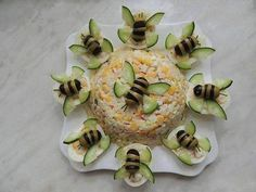 Sweet Home: Fun salads. Bees made with black and green olives and cucumber wings… Sweet Home: Fun salads. Bees made with black and green olives and cucumber wings, appears to be egg salad, bees sitting on halved hard boiled eggs. Bug Snacks, Snacks Für Party, Fruit Snacks, Snacks Ideas, Fun Fruit, Rainbow Fruit, Dessert Party, Keto Snacks, Fruit Appetizers
