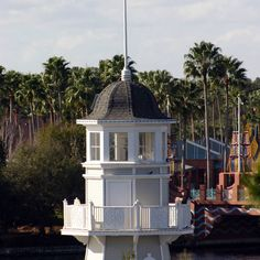 Here is a view of the lighthouse by Disneys Yacht Club and Beach Club Resorts that you don't get to see very often!  Picture was taken from the balcony of a 5th floor (club level) room at the Beach Club Resort with a 75-300 zoom lense.  The bridge to the Dolphin and Swan Resorts is visible in the background.  Man I love the Beach Club area!  #disneyworld #lighthouse #beachclubresort #yachtclubresort #beachclub #yachtclub #clublevel