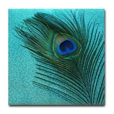Metallic Aqua Blue Peacock Tile Coaster.    The  drink coaster in blue and green look great with the peacock bird feather.