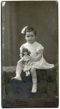 Vintage photo of a Hungarian girl with her doll.