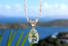 Green quartz pendant with beautiful Meagan's Bay in the background. #usvi #vibecollection #naturalbeauty