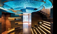 Nettleton 198 House, by Stefan Antoni Olmesdahl Truen Architects (SAOTA), in Cape Town, South Africa. The circular entrance area features ceiling lights made of slumped glass lit from above, giving the appearance of rippling water.