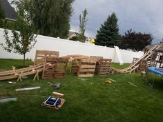 Backyard roller coaster using primarily pallets. Cost a whopping $50 to build!! How awesome would this be???!