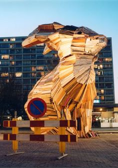 The Giant of Vlaardingen  2002- 2003  8 x 10,5 x 5,5 meters  Salvaged wood, nails and screws    It took three months to build to a sculpture out of salvaged wood, with the assistance of local people. The sculpture is an assemblage, and although the quality of the wood was poor, it stood on three locations