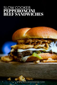 With just 10 minutes prep, these Slow Cooker Pepperoncini Beef Sandwiches are the perfect combo of succulent beef, melty cheese and crispy fried onions. #slowcooker #crockpot #beef #sandwiches #easyrecipe #mozzarella