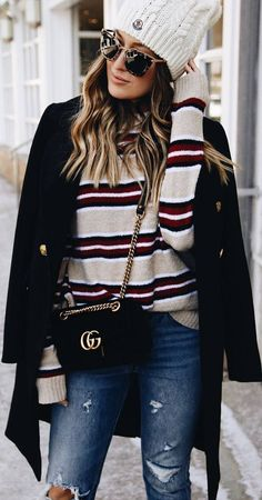 #winter #outfits ripped jeans, striped beige sweater, black coat