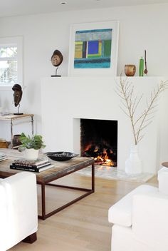 love the painting over the fireplace!  (the African masks are pretty cool, too)
