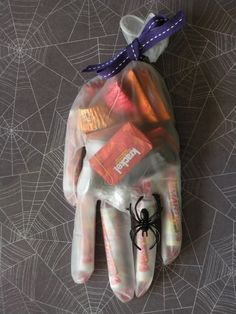 "Halloween Hand Treats - Take away the Hallooween theme, put a card saying ""You deserve a hand"" fill with candy put a cute bow on it. You could also go to your local store in the party section and find cute rings to put onto the finger.                                                                                                                                                     More"