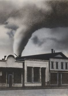 """International News Photo: """"The Portent of Coming Disaster: A Tornado, Photographed as It Moved across the Sky toward White, S.D., by a Cameraman Who Was the Only Person Who Did Not Take Shelter in a Cyclone Cellar. None of the Buildings Shown in the Picture Was Damaged, as They Were Not in the Direct Path of the Tornado,"""" 1938. (Courtesy of The Museum of Modern Art, New York. The New York Times Collection. © 2016 International News Photo)"""