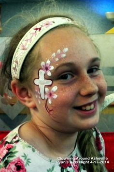 Cross  Flowers Girl face painting Clowning Around Asheville Face Painting  Balloon Twisting