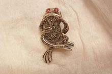 Aprils always something exciting in store sale Many items from 10-60% off Marcasite red eye sterling frog with a tude Brooch
