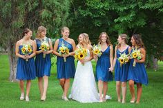Short, blue mix and match bridesmaid dresses with sunflower bouquets {Alison D. Photography}