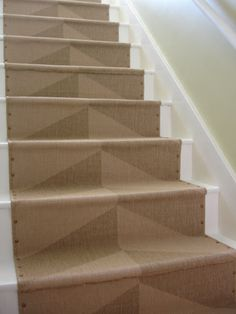 We love a great Ikea hack. These inexpensive rugs by the retailer make a rugged and stylish staircase runner. FYI this DIY cost under 250 dollars. #staircase_runner #loftandcottage #Ikea_hack #staircase_diy #staircase_makeover #staircase_remodel #houselogic #foyer_makeover #staircase_ideas #foyer_ideas