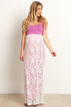 Just in time for Spring and Valentine's Day, this gorgeous lace colorblock maternity maxi dress is the perfect feminine piece for your wardrobe this season. A solid top and delicate, lace bottom this maxi dress is the ultimate date night essential. Style this lovely maternity dress with a long necklace and strappy sandals to complete the look.