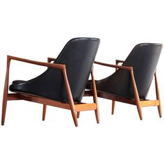 Ib Kofod-Larsen Pair of Elizabeth Chairs in Teak and Black Leather | From a unique collection of antique and modern lounge chairs at https://www.1stdibs.com/furniture/seating/lounge-chairs/
