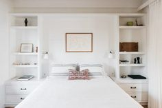 built in nightstands and shelves around bed