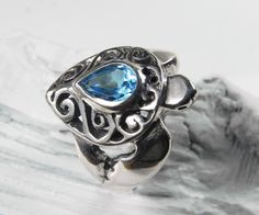 I fell in love with sea turtles all over again when I visited the Sea Turtle hospital on Topsail island NC this summer!  Turtle Ring - Sea Turtle Ring - Sterling Silver Blue Topaz - Unique Sea Turtle Jewelry - Ocean Inspired - Aqua Blue.  via Etsy.