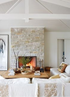 Discover House & Home's Best White Paint Colors – Stone fireplace living room Limestone Fireplace, Home Fireplace, Modern Fireplace, Living Room With Fireplace, Fireplace Design, Living Room Decor, Fireplace Ideas, Fireplace Remodel, Cream Fireplace