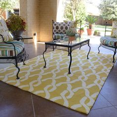 Add colorful fun to your living space with this large indoor/outdoor rug that is specially designed to be resistant to the elements. It is made from durably rugged polypropylene, and it is also resistant to mold and mildew for added convenience.