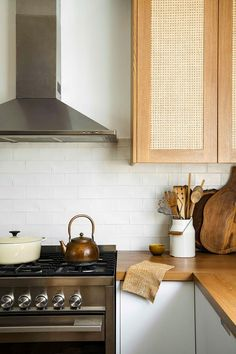 kitchen with wooden benchtops, white and rattan cabinetry Wooden Benchtop Kitchen, Kitchen Benchtops, Kitchen Cabinetry, Kitchen Interior, Kitchen Decor, Earthy Kitchen, Kitchen Trends, Kitchen Ideas, Kitchen Designs