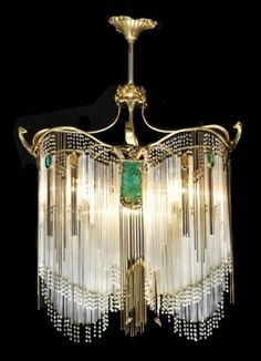 This Art Nouveau ormolu 5 light chandelier is made in the manner of Hector Guimard. This light fixture is stunning, w/ 10 colored glass panels & brass & tubular glass drops. Lampe Art Deco, Art Deco Decor, Art Deco Chandelier, Antique Chandelier, Art Deco Lighting, Antique Lamps, Antique Lighting, Vintage Lamps, Decoration