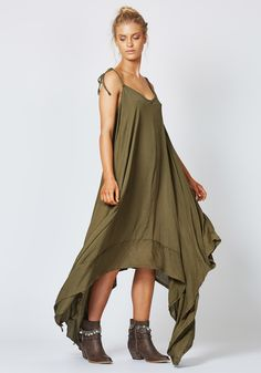 New from Times Ten the label Resolution dress in khaki.    Full dress in gorgeous super soft rayon shot with a delicate lurex stripe - adjustable straps with tie detail - raw edge detail on hem panel - easy fit - dramatic handkerchief hemline  100% rayon    xsmall bust 78cm, waist 60cms and hips 87cms    small bust 83cm, waist 65cms and hips 92cms    med bust 88cm, waist 70cms and hips 97cms    large bust 93cm, waist 75cms and hips 102cms    xlarge bust 98cm, waist…