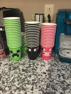 Minecraft Birthday party cups. Cut out faces with card stock and used tape to stick to cups