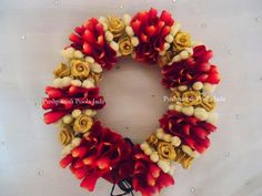 veni or gajra made with real rose petals,real jasmine buds and artificial gold roses.