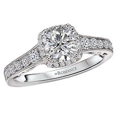 www.cmijewelry.com Item # 117924-100 Tapered Diamond Halo Ring in 18kt White Gold with Milgrain Detail. (D 1/3 carat total weight) This item is a SEMI-MOUNT and it comes with NO CENTER STONE as shown but it will accommodate a 6.5mm round center stone.