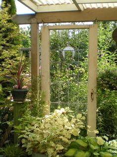 Old door hung in a garden by Gardening With Grace