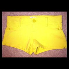 Yellow Shorts Bright yellow shorts. Cotton and spandex material. X-small. Tag says size 1. Jeans