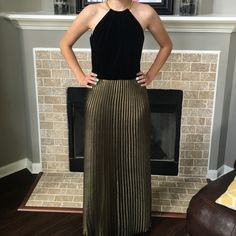"""Laundry Black Velvet & Gold Gown This dress is a show stopper! From its unusual gold necklace neckline to its """"accordion"""" pleated skirt to its peek a boo back, you will look and feel like an A lister! Laundry by Design Dresses Prom"""