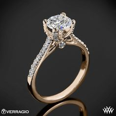 This Diamond Engagement Ring is from the Verragio Couture Collection. It  features 0.30ctw of Round Brilliant Diamond Melee (F/G VS) that enhance a round diamond center of your choice. The width of this ring is 1.8mm. Select your diamond from our extensive online diamond inventory. Please allow 4 weeks for completion. Platinum rings carry a 5 week turnaround time. If you have any questions regarding this item then please contact one of our friendly diamond and jewelry consultants at…