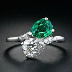 1950's platinum and diamond ring set with tapered baguettes and pear shaped diamond and emerald. 'Bypass' ring.