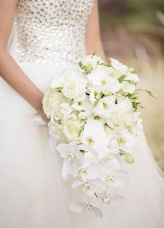classically elegant white cascading wedding bouquet of roses and orchids