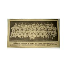 "A reprint baseball photo which is a menu on the back. The menu has ""The Wheel Cafe Congratulates The Cincinnati Reds National League Champions of 1939"" on the front along with a photo of the players and their names below."