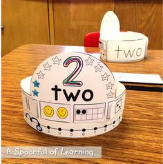 Number Hats: tally marks, 2 smile faces, ten frame, die, number line, word, color # stars, trace numeral, XL word on left back side, tracing numerals on right back side http://www.farrellandcompany.com/shop/j29fgdzxqamnu49hd4pun0xnl5cf3p A Spoonful of Learning: Numbers, Numbers, Numbers! & FREEBIES!