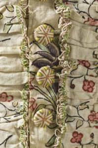 """LACMA Sack Back, Compere Front. 1770: Like many 18th century buttons, the ones featured are known as """"Deathshead"""" (or deaths head). These are created by winding lengths of thread/silk/yarn around a button mould."""""""