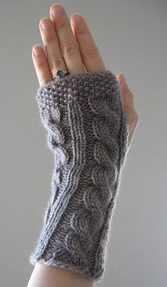 Free easy knitting pattern for Irish Hiking Scarf Mitts - Delia Rau Cholakian's cable arm warmers are knit flat, then seamed, leaving a hole for the thumb. In the pictured project, acmiller substituted seed stitch for the ribbing.