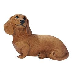 Brown Dachshund Puppy Dog Statue. Few can deny the tug-at-the-heartstrings draw of this timeless image of man's best friend. Designed in Bagni di Lucca, Italy by the artisans of the renowned Castagna workshop, each Dachshund puppy statue is researched for authenticity of breed. #dachshund #dog #statue