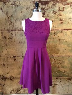 Feminine dress from London with the perfect amount of detail. Floral lace overlay, pockets, and the greatest color to brighten the coming months.