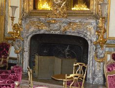 Exceptional fireplace made out of Fleur de Pêcher marble (Peach Flower marble) with bronze putti features decorating the Napoleon III appartments in the Louvre Palace. Louvre Palace, Marble House, Napoleon Iii, Second Empire, Shades Of Purple, City Lights, French Antiques, Peach, Bronze
