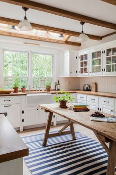 Love this striped area rug in the kitchen!