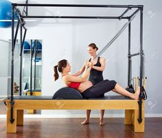 44215988-pregnant-woman-pilates-reformer-roll-up-cadillac-exercise-with-personal-trainer-Stock-Photo.jpg (1300×1115)